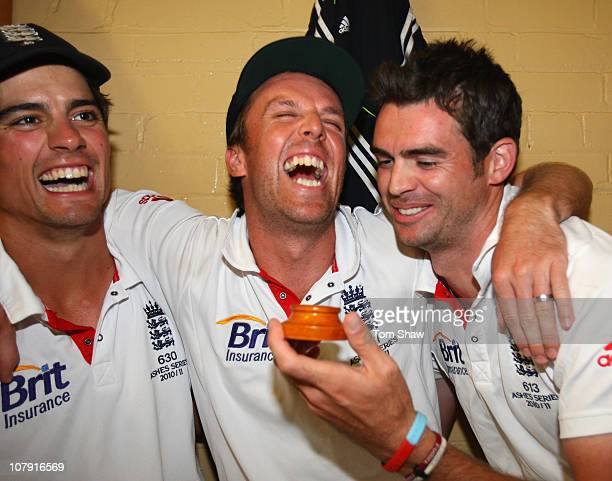 Alastair Cook Graeme Swann and James Anderson of England celebrate in the dressing room with the ashes urn after winning the series 31 during day...