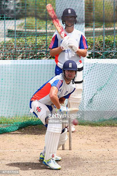 Alastair Cook is watched closely by Jonathan Trott during batting practise during the England nets session at Kensington Oval ahead of the 3rd Test...