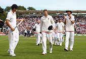 Alastair Cook Joe Root and Stuart Broad of England walk from the ground after day four of the 1st Investec Ashes Test match between England and...