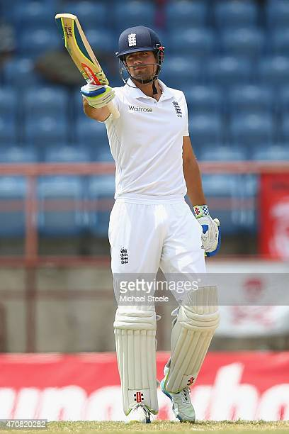 Alastair Cook of England acknowledges the crowd as he reaches his fifty during day three of the 2nd Test match between West Indies and England at the...
