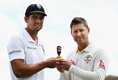 Alastair Cook of England and Michael Clarke of Australia pose with the Ashes Trophy ahead of the 1st Investec Ashes Test match between England and...