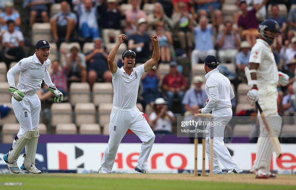 <a gi-track='captionPersonalityLinkClicked' href=/galleries/search?phrase=Alastair+Cook+-+Cricket+Player&family=editorial&specificpeople=571475 ng-click='$event.stopPropagation()'>Alastair Cook</a> (2L) of England celebrates catching <a gi-track='captionPersonalityLinkClicked' href=/galleries/search?phrase=Shikhar+Dhawan&family=editorial&specificpeople=650580 ng-click='$event.stopPropagation()'>Shikhar Dhawan</a> of India off the bowling of <a gi-track='captionPersonalityLinkClicked' href=/galleries/search?phrase=James+Anderson+-+Cricket+Player&family=editorial&specificpeople=6920305 ng-click='$event.stopPropagation()'>James Anderson</a> during day two of the 3rd Investec Test match between England and India at the Ageas Bowl on July 28, 2014 in Southampton, England.