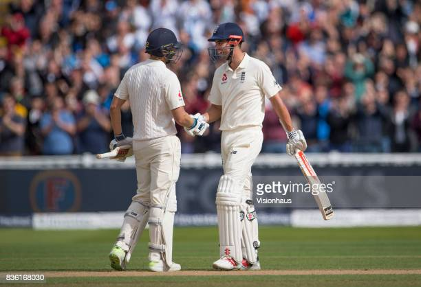 Alastair Cook of England celebrates reaching his double century and is congratulated by Dawid Malan during day two of the 1st Investec test match...