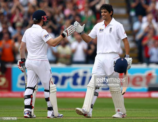 Alastair Cook of England celebrates reaching his double century with Eoin Morgan during day three of the 3rd npower Test at Edgbaston on August 12...