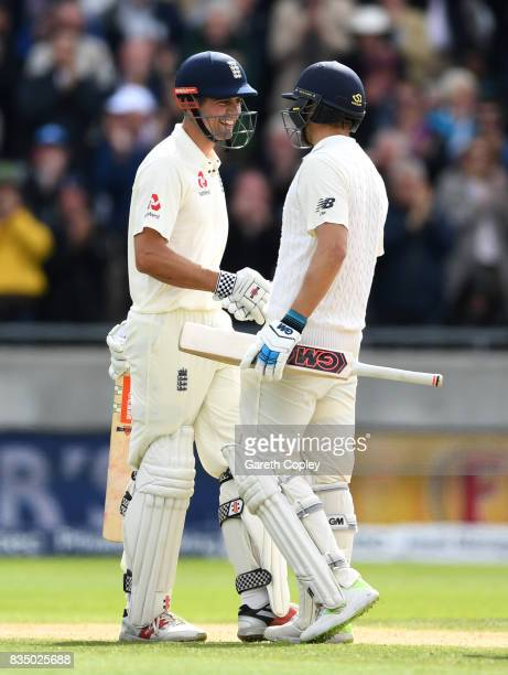 Alastair Cook of England celebrates with Dawid Malan after reaching his double century during day two of the 1st Investec Test match between England...