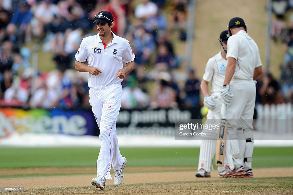 <a gi-track='captionPersonalityLinkClicked' href=/galleries/search?phrase=Alastair+Cook+-+Cricket+Player&family=editorial&specificpeople=571475 ng-click='$event.stopPropagation()'>Alastair Cook</a> of England fields during a brief rain shower during day four of the second Test match between New Zealand and England at Basin Reserve on March 17, 2013 in Wellington, New Zealand.