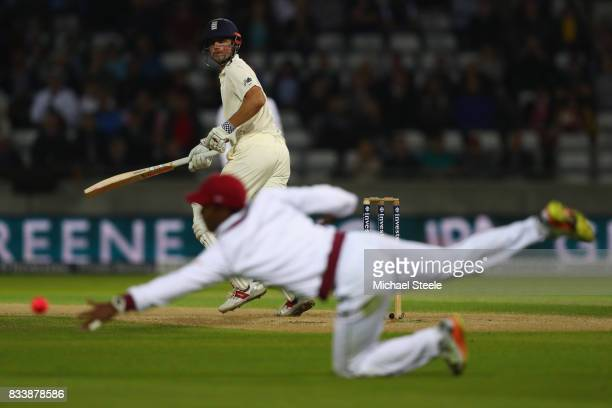 Alastair Cook of England guides a shot to the third man boundary during day one of the 1st Investec Test match between England and West Indies at...