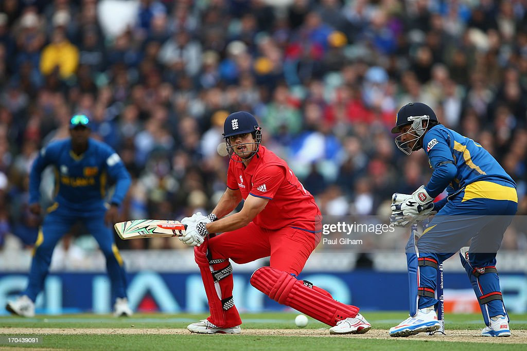 Alastair Cook of England hits out as Kumar Sangakkara of Sri Lanka looks on during the ICC Champions Trophy Group A match between England and Sri Lanka at The Kia Oval on June 13, 2013 in London, England.