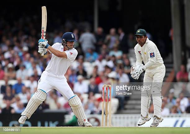 Alastair Cook of England hits out watched by wicketkeeper Kamran Akmal of Pakistan during day three of the npower 3rd Test Match between England and...