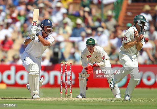 Alastair Cook of England hits the ball into the back of Simon Katich of Australia as wicketkeeper Brad Haddin of Australia looks on during day two of...