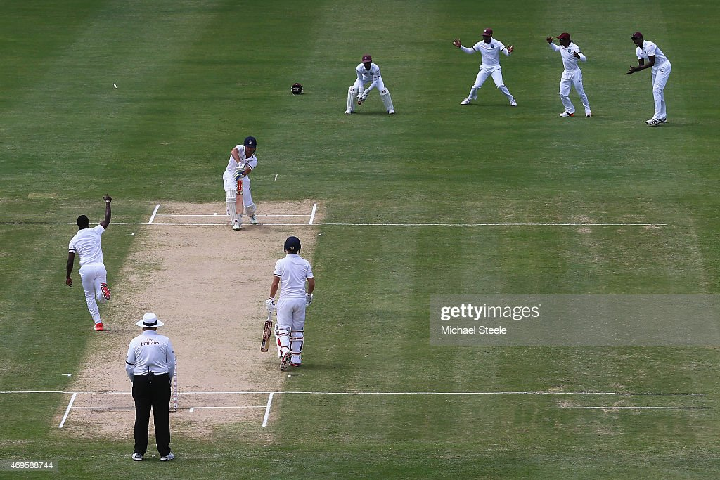 <a gi-track='captionPersonalityLinkClicked' href=/galleries/search?phrase=Alastair+Cook+-+Cricketspieler&family=editorial&specificpeople=571475 ng-click='$event.stopPropagation()'>Alastair Cook</a> of England is bowled by <a gi-track='captionPersonalityLinkClicked' href=/galleries/search?phrase=Kemar+Roach&family=editorial&specificpeople=5408487 ng-click='$event.stopPropagation()'>Kemar Roach</a> of West Indies during day one of the 1st Test match between West Indies and England at the Sir Vivian Richards Stadium on April 13, 2015 in Antigua, Antigua and Barbuda.