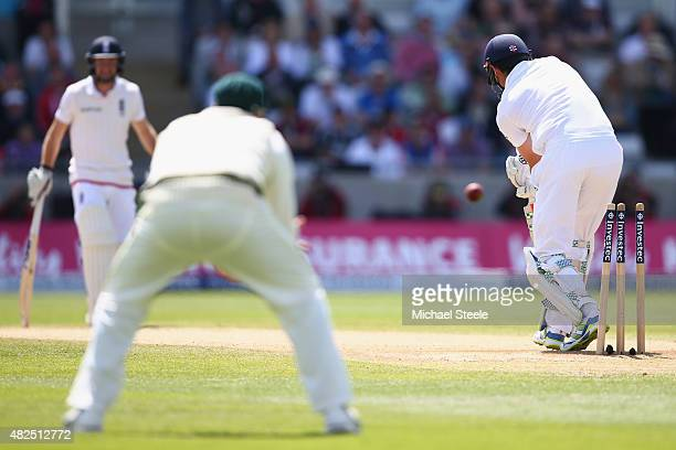 Alastair Cook of England is bowled by Mitchell Starc of Australia during day three of the 3rd Investec Ashes Test match between England and Australia...