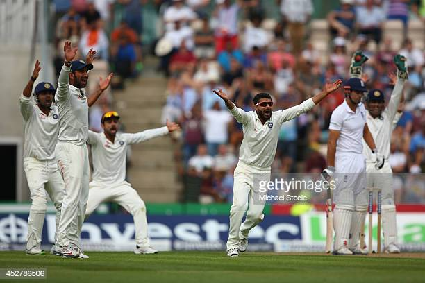 Alastair Cook of England is caught for 95 runs by wicketkeeper MS Dhoni off the bowling of Ravindra Jadeja of India during day one of the 3rd...