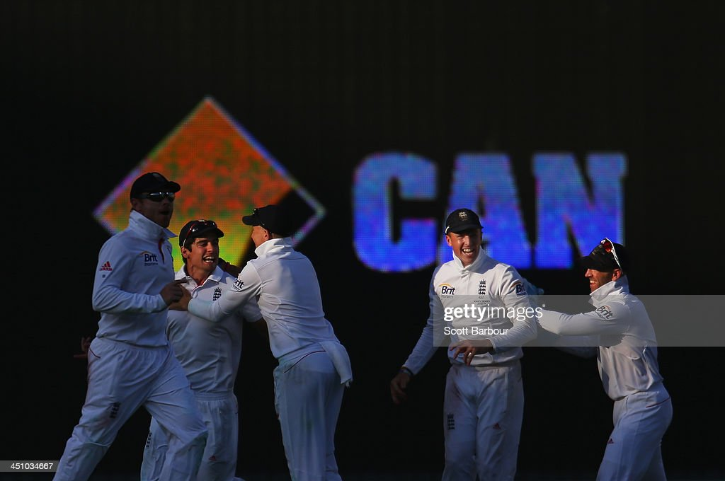 Alastair Cook of England is congratulated by his teammates after taking a catch at first slip to dismiss Peter Siddle of Australia during day one of the First Ashes Test match between Australia and England at The Gabba on November 21, 2013 in Brisbane, Australia.