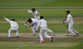 Alastair Cook of England is trapped lbw for 56 runs by Kane Williamson of New Zealand for during day five of the 2nd Investec Test Match between...