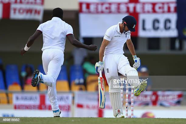 Alastair Cook of England kicks out in frustration after being dismissed for 13 runs caught by Sulieman Benn off the bowling of Jerome Taylor of West...