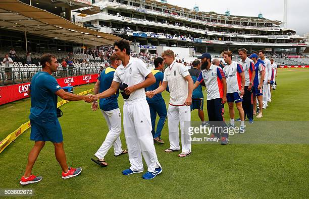 Alastair Cook of England leads the hand shakes as the match is drawn during day five of the 2nd Test at Newlands Stadium on January 6 2016 in Cape...