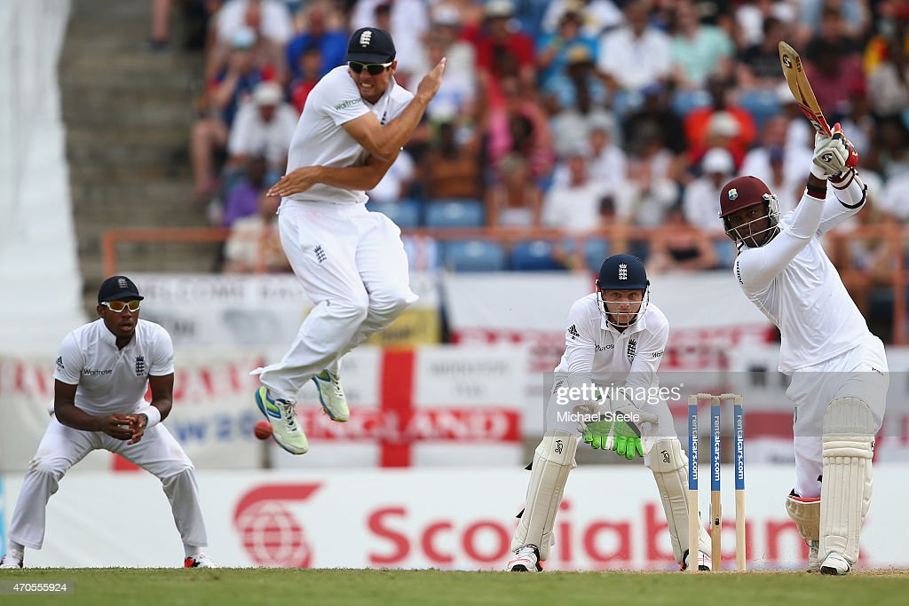 <a gi-track='captionPersonalityLinkClicked' href=/galleries/search?phrase=Alastair+Cook+-+Cricket+Player&family=editorial&specificpeople=571475 ng-click='$event.stopPropagation()'>Alastair Cook</a> of England leaps to avoid a cover drive from <a gi-track='captionPersonalityLinkClicked' href=/galleries/search?phrase=Marlon+Samuels&family=editorial&specificpeople=185235 ng-click='$event.stopPropagation()'>Marlon Samuels</a> of West Indies during day one of the 2nd Test match between West Indies and England at the National Cricket Stadium in St George's on April 21, 2015 in Grenada, Grenada.