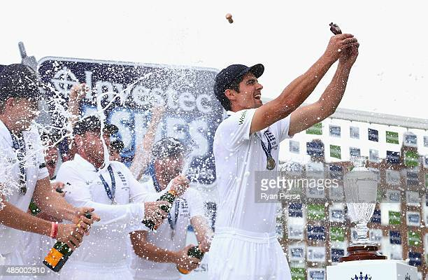 Alastair Cook of England lifts the Ashes Urn during day four of the 5th Investec Ashes Test match between England and Australia at The Kia Oval on...