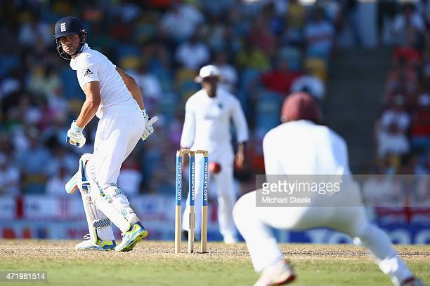 Alastair Cook of England looks back as he edges a catch to Kraigg Brathwaite of West Indies at slip to be dismissed off the bowling of Shannon...