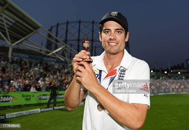 Alastair Cook of England poses with the urn after winning the Ashes during day five of the 5th Investec Ashes Test match between England and...