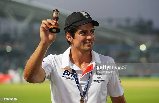 Alastair Cook of England poses with urn after winning the Ashes during day five of the 5th Investec Ashes Test match between England and Australia at...