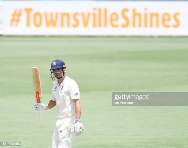 Alastair Cook of England raises his bat after reaching a half century during day 2 of the four day tour match between Cricket Australia XI and...