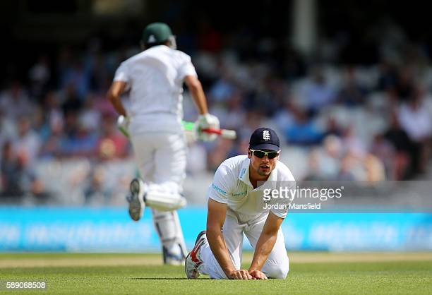 Alastair Cook of England reacts as he watches a ball from Younus Khan of Pakistan run out for four during day three of the 4th Investec Test between...