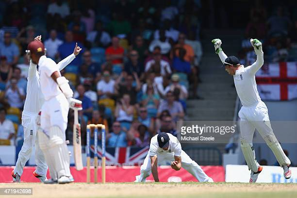 Alastair Cook of England takes a catch at 1st slip to claim the wicket of Shai Hope of West Indies off the bowling of James Anderson during day two...