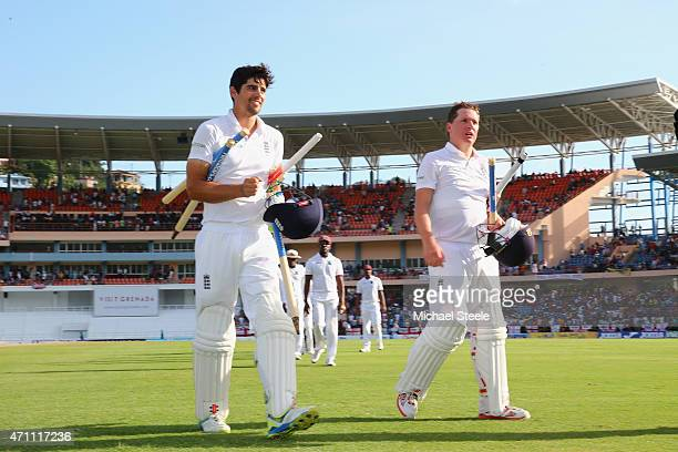 Alastair Cook of England undefeated on 59 runs and Gary Ballance undefeated on 81 runs celebrate victory by nine wickets over West Indies during day...