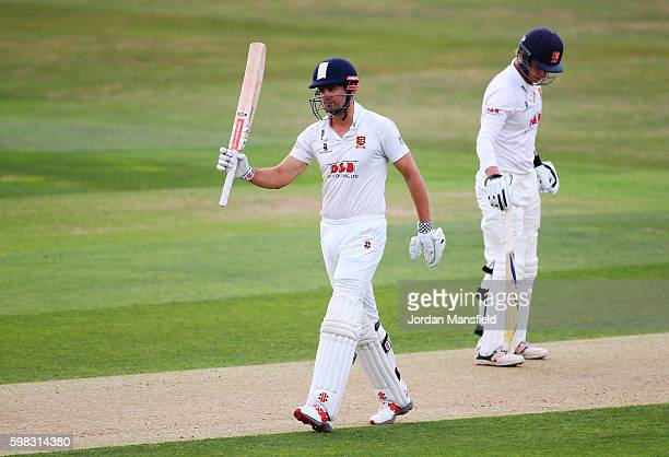 Alastair Cook of Essex celebrates his 50 during day two of the Specsavers County Championship Division Two match between Essex and Worcestershire at...