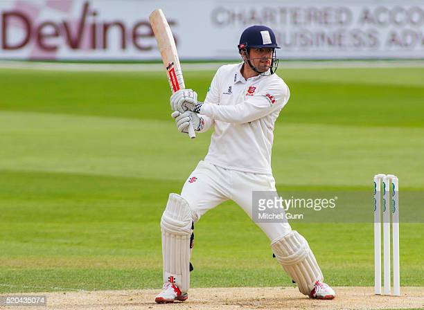 Alastair Cook of Essex hits the ball for four runs to score his century during the Specsavers County Championship match between Essex and...