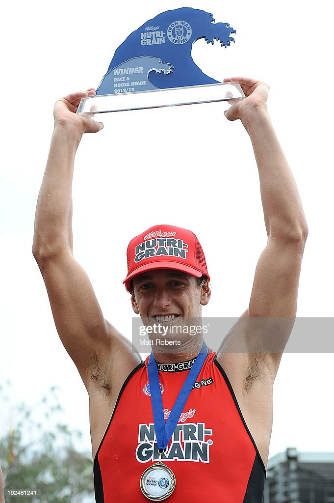 Alastair Day holds the winner trophy aloft after the Noosa Heads round of the 2012 Kelloggs Nutri-Grain Ironman Series on February 24, 2013 in Noosa, Australia.