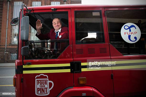 Alastair James Hay better known as comedian 'Al Murray' who portrays an English pub landlord arrives in a converted fire engine to hand in his...