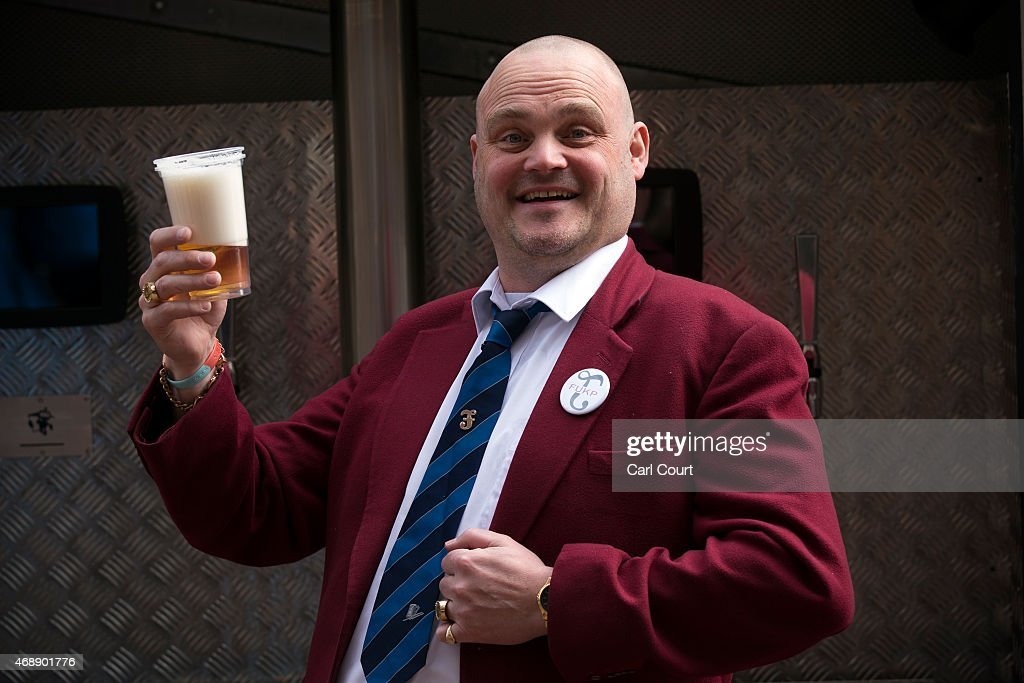Alastair James Hay better known as comedian 'Al Murray' who portrays an English pub landlord poses with a pint of beer poured from a fire engine...