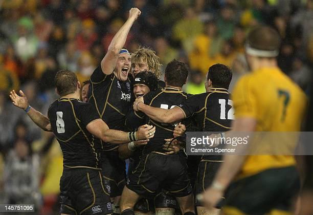 Alastair Kellock of Scotland and team mates celebrate winning the International Test match between the Australian Wallabies and Scotland at Hunter...