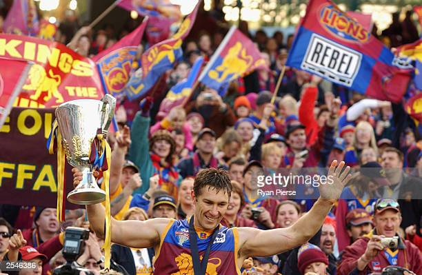 Alastair Lynch for the Lions celebrates with the trophy after the AFL Grand Final between the Collingwood Magpies and the Brisbane Lions at the...