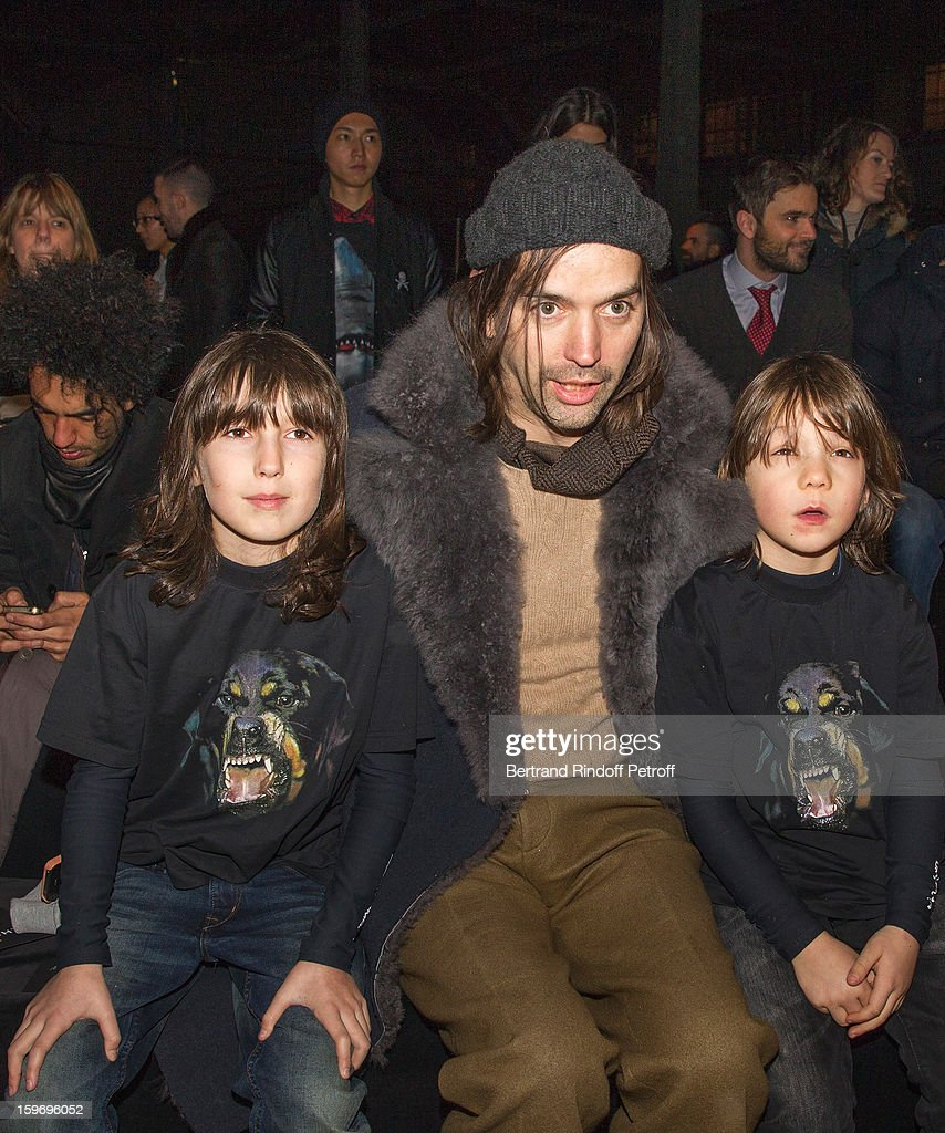 Alastair Mackie (C) and the sons of Bobby Gillespie, Wolf (L) and Lux attend the Givenchy Men Autumn / Winter 2013 show as part of Paris Fashion Week on January 18, 2013 in Paris, France.