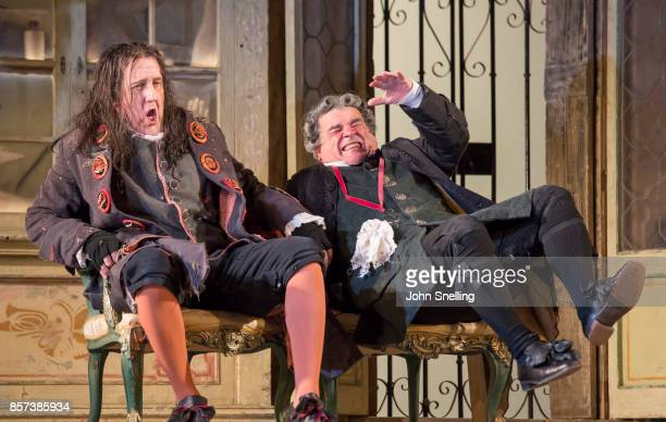 Alastair Miles as Basilio and Alan Opie as Bartolo perform on stage during a performance of Jonathan Millers classic production of 'The Barber of...