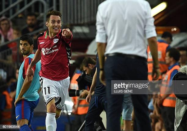 Alaves' forward Ibai Gomez celebrates goal as Barcelona's Uruguayan forward Luis Suarez looks at him during the Spanish league football match FC...