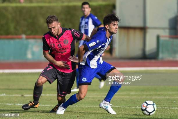 Alaves' French midfielder Enzo Zidane challenges Toulouse's French midfielder Alexis Blin during a friendly football match between Toulouse and...