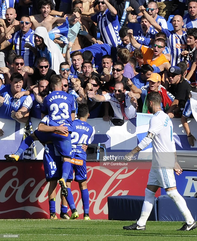 Alaves players celebrate after scoring their first goal during the Spanish league football match Deportivo Alaves vs Real Madrid CF at the Mendizorroza stadium in Vitoria on September 23, 2017. /