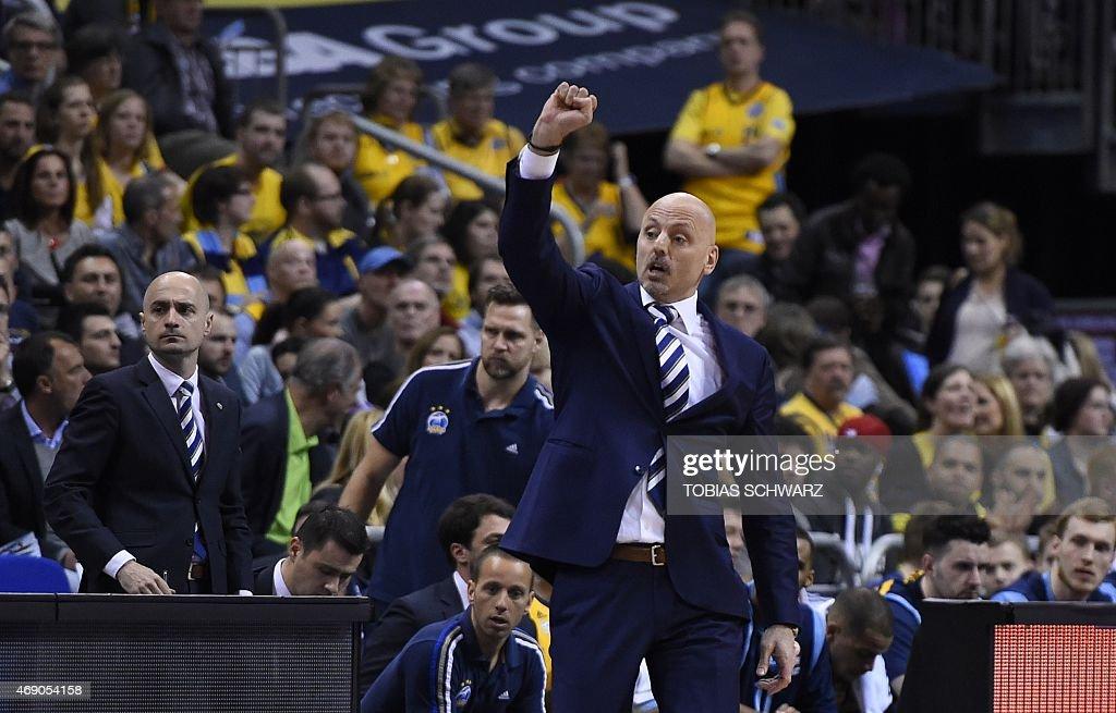 Alba Berlin's Serbian coach Sasa Obradovic reacts during the Euroleague basketball match Alba Berlin vs Maccabi Tel Aviv at the O2 Arena in Berlin on April 9, 2015.