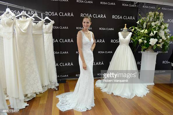Alba Carrillo poses for the press during a fitting for designer Rosa Clara and will be presented during the 'Barcelona Bridal Fashion Week 2014' on...