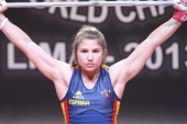 Alba Cecilia Belardi Barrera of Spain A competes in the Women's 53kg snatch during day two of the 2013 Junior Weightlifting World Championship at...