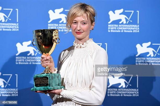 Alba Rohrwacher poses with the Coppa Volpi for best Actress award she received for the movie 'Hungry Hearts' during the award winners photocall...