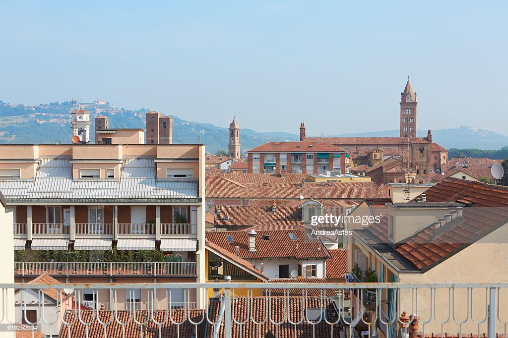 Alba rooftops with cathedral's bell tower view, Italy : Foto de stock