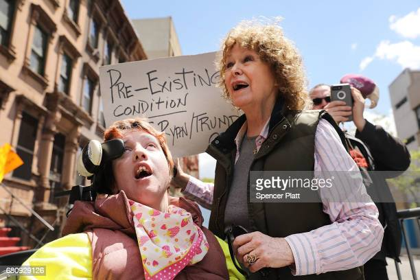 Alba Somoza who has cerebral palsy attends a rally with her mother Mary and dozens of healthcare activists in front of a Harlem charter school before...