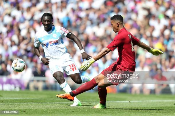 Alban Lafont of Toulouse and Bafetimbi Gomis of Marseille during the Ligue 1 match between Toulouse FC and Olympique de Marseille at Stadium...