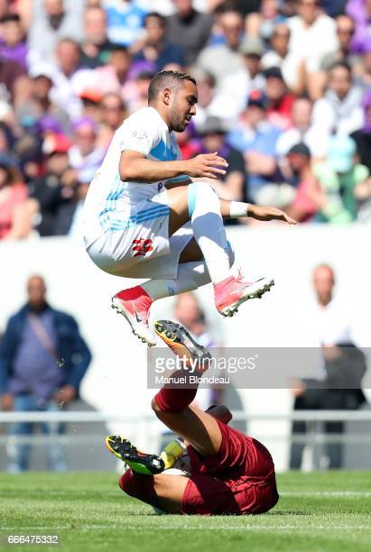 Alban Lafont of Toulouse and Dimitri Payet of Marseille during the Ligue 1 match between Toulouse FC and Olympique de Marseille at Stadium Municipal...